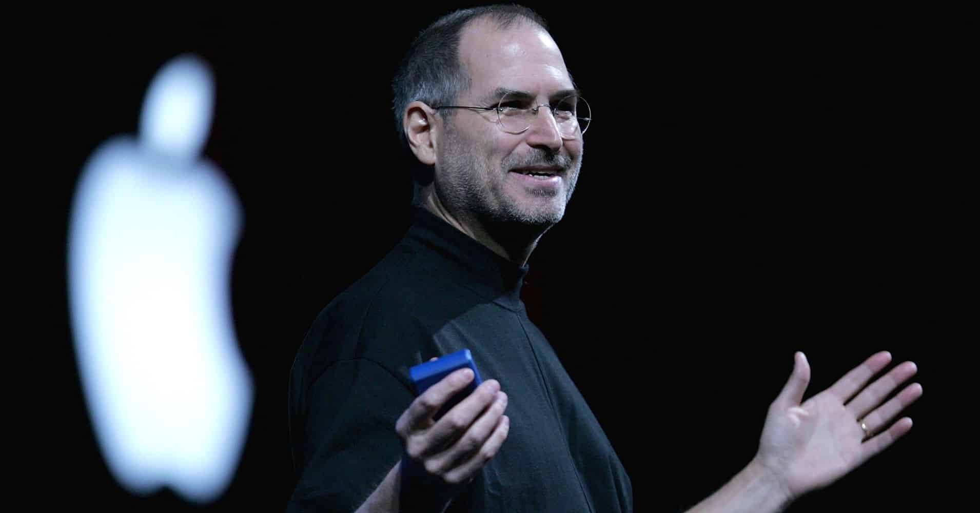 Steve Jobs on a stage at an Apple event