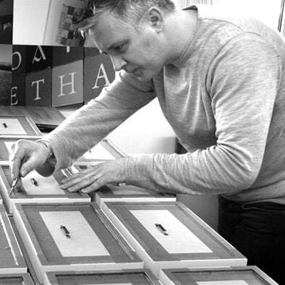 Joe in the Studio working our Personalised Gifts