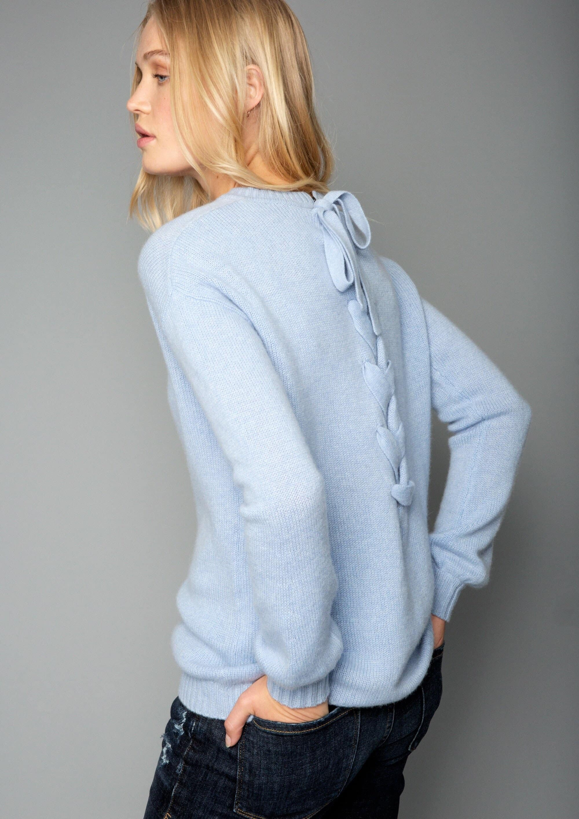 woman in a blue knitwear jumper